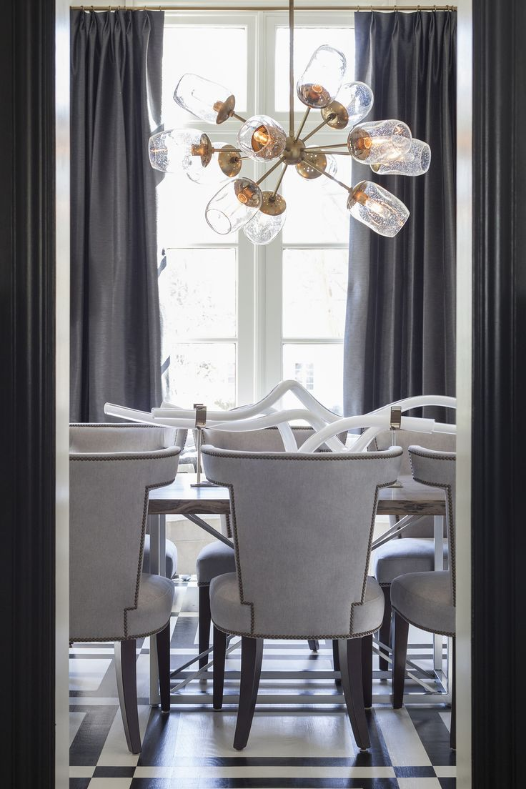 Modern eccentric dining room design with statement hanging light fixture   Lucy and Company