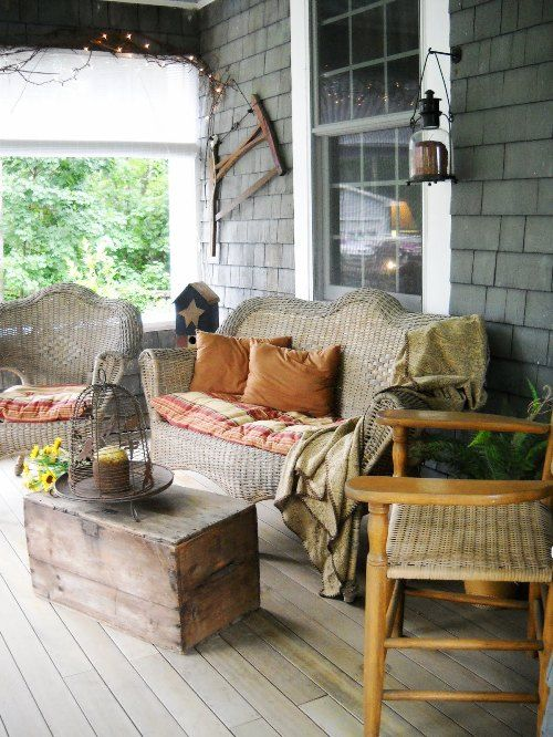 Such a comfortable porch setting... love the color accents  and the prim touches!!  Feast your eyes!