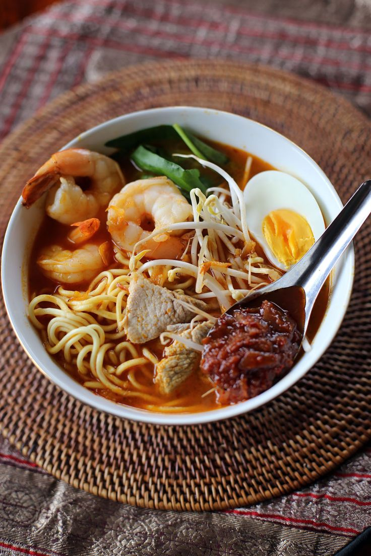 Penang Hokkien Mee - a spicy noodle soup dish topped with bean sprouts, spinach, eggs, prawns, pork and sambal. The broth is amazing; made by frying and cooking prawn shells with shallots and chilli paste in a chicken stock, giving it a rich flavor and pleasant aroma.