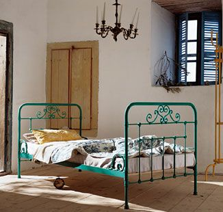 teal colored wrought iron bed frame