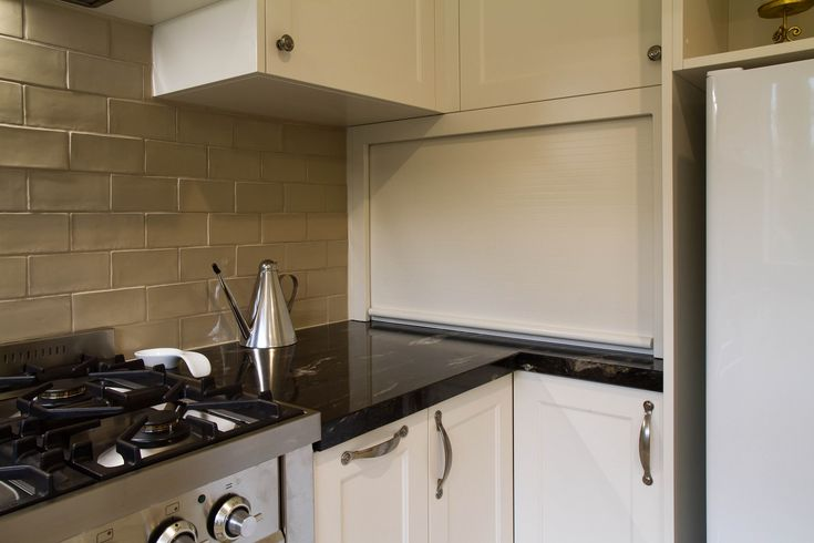 Large traditional kitchen with granite benchtops. Corner appliance pantry with a roller door. www.thekitchendesigncentre.com.au @thekitchen_designcentre