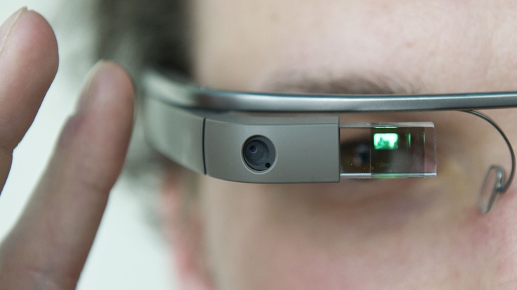 "A visitor at the ""NEXT Berlin"" conference tries out Google Glass on April 24 in Berlin."