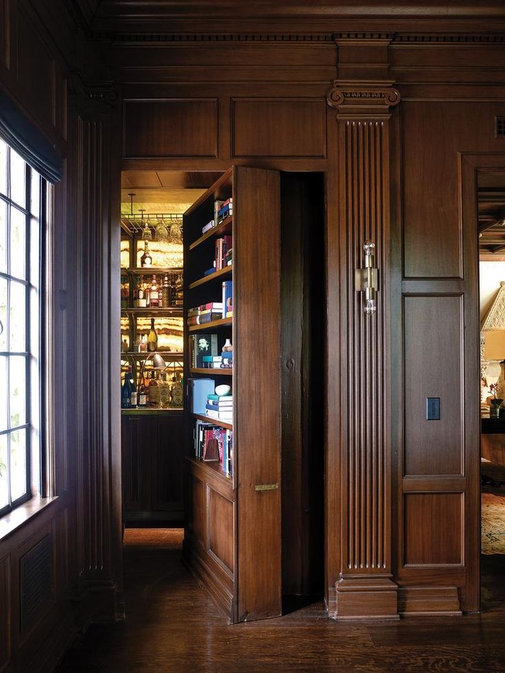 "<strong>SECRET SHARER</strong> | A bookcase in the library opens to reveal a speakeasy bar—one of Smith's favorite spots in the house, which he's dubbed ""the drinking room."""