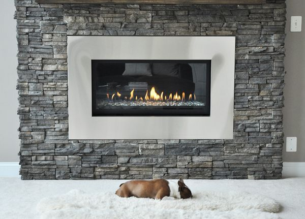 I like the look of this fireplace insert (size, stainless steel). Mitch has mentioned that he likes the look of stacked rock. Maybe?