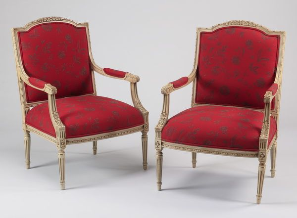 pair of gustavian style armchairs the carved frame with reeded foliate decoration red