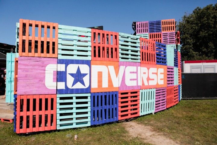 Stacked multi-colored and branded pallets for an entrance, backdrop or anything you can imagine!