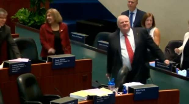 Toronto Mayor Rob Ford and the city council dance to Bob Marley's' One Love. Rough Cut.