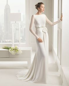 long sleeved white wedding dress with simple bow sash and slinky skirt