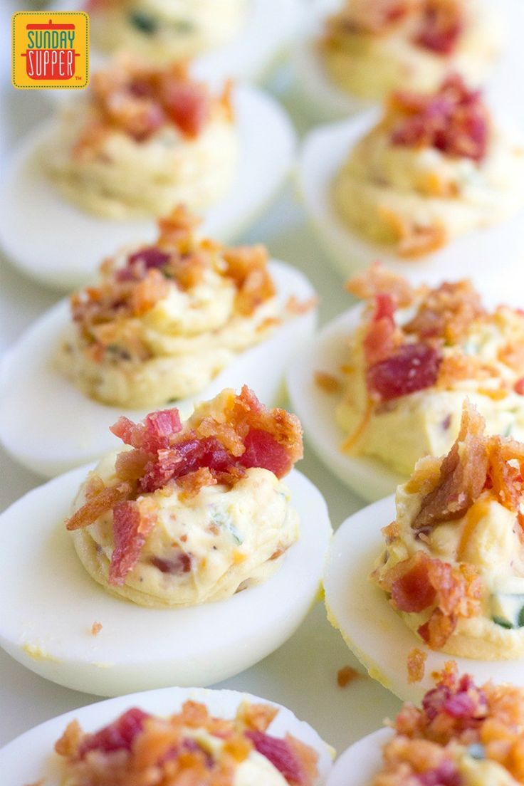 Jalapeno Popper Deviled Eggs are an easy party appetizer that's perfect for everything from game day gatherings to parties and cookouts too! A spicy twist on a classic favorite, you'll want to take these deviled eggs to all of your potluck events. #SundaySupper