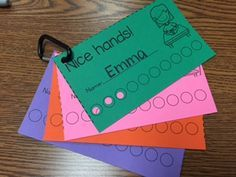 Behavior punch cards! So easy and saves ink. Kids love them.