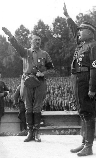 Röhm salutes Hitler during the Nazi Party-day rally at Nuremberg in September 1933 - ever-dutiful in public but increasingly contemptuous of Hitler in private.