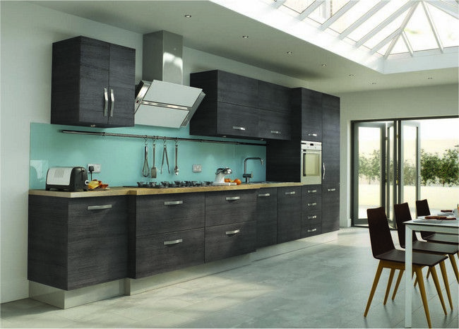 Row of grey kitchen cabinets with metal handles