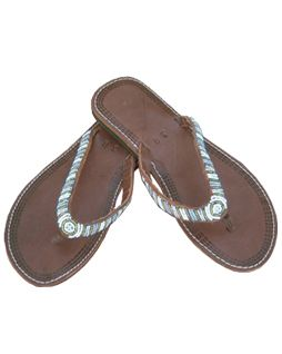 Aspiga Blue Striped Flip Flop These elegant striped flip flops come on a flat sole and have a round toe. They have alternating rows of white and blue beads sewn running down the straps meeting at a small disc on the toe post. http://www.comparestoreprices.co.uk/womens-shoes/aspiga-blue-striped-flip-flop.asp