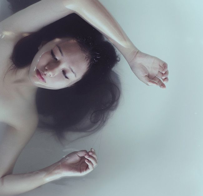 Woman floating in water, Isabel Cassell // photography