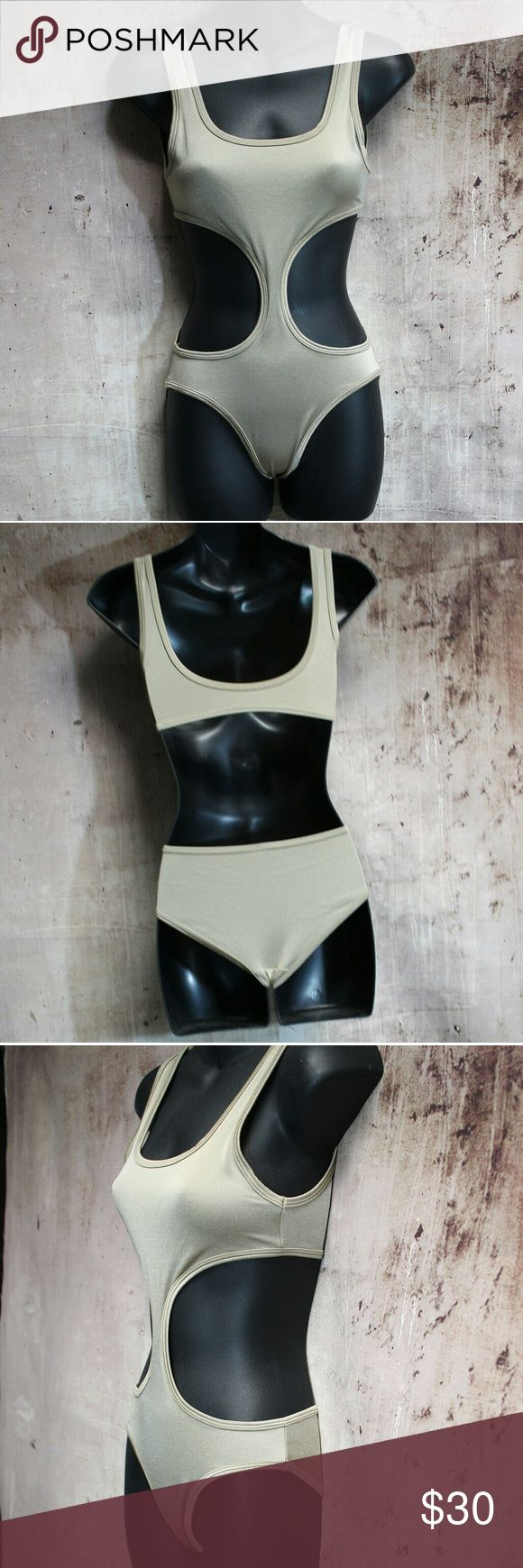 American Apparel Shiny Gold Cut Out Swimsuit NWOT AA swimsuit. No runs, tears or snags. Size small. American Apparel Swim One Pieces
