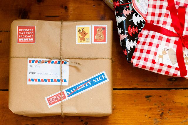 Santa Wrapping. free printable labels for a special package from Santa!  (either by elf, or how arrives, or something mid December as a little early surprise... or the Christmas eve jammies!!!)