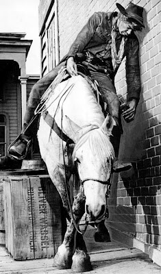 """Lee Marvin, as the hungover Kid Shelleen (with hungover horse) in """"Cat Ballou."""" 1965."""