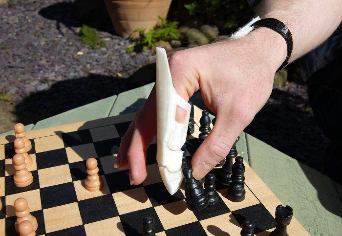 Minerva Prosthetic Finger playing chess