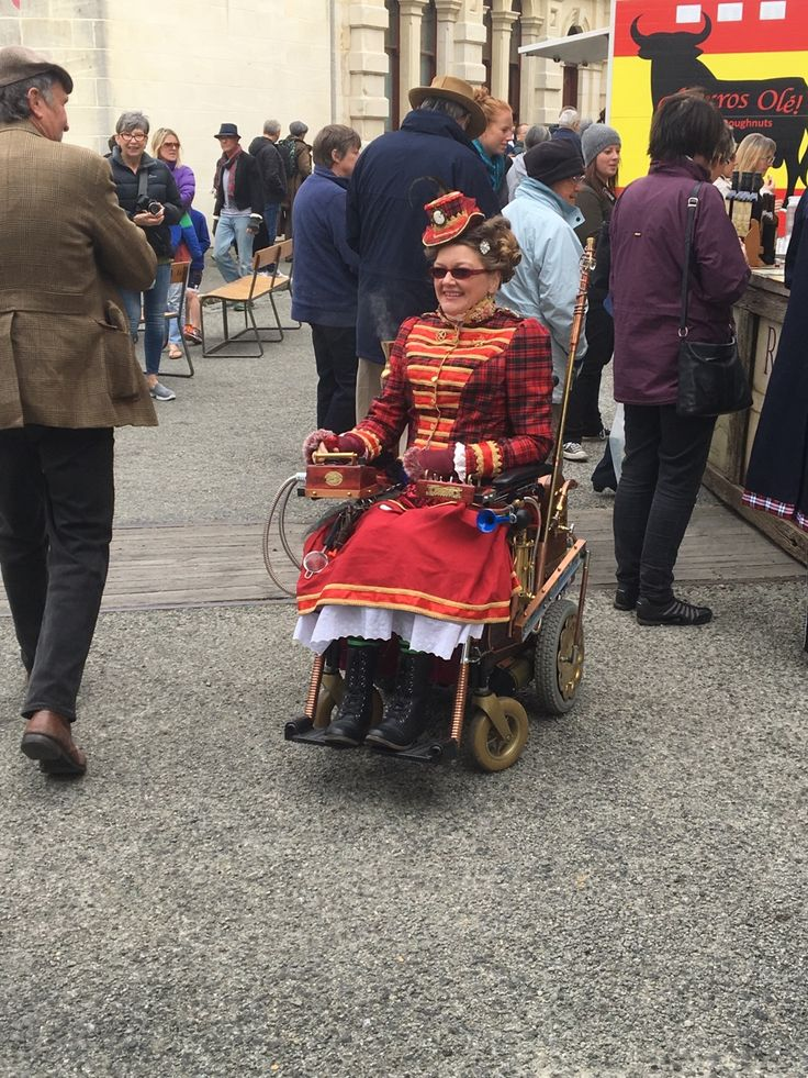 Working steam punk wheel chair. This young lady was crushed by a farm tractor and after as much healing as possible her partner and others constructed a working mechanical marvel complete with working steam exhausts. Everything filly functional a work of great love