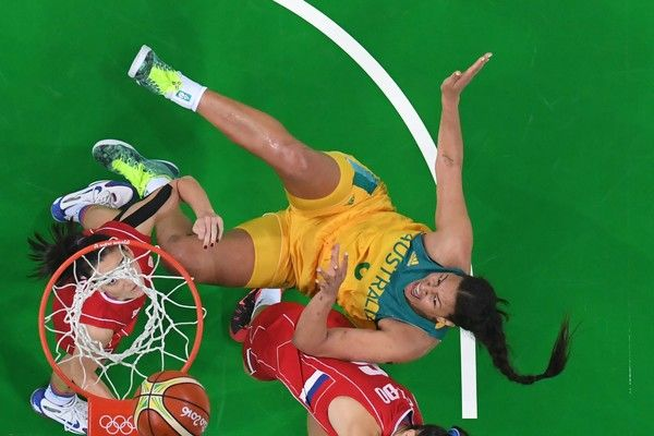 An overview shows Australia's centre Elizabeth Cambage (R) fall during a Women's…