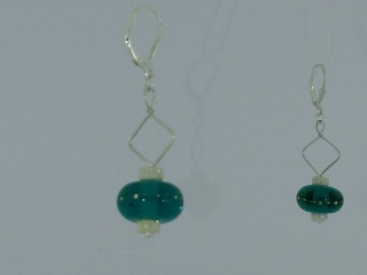 Emerald glass with pure silver drops. Both glass and silversmith by me  :)