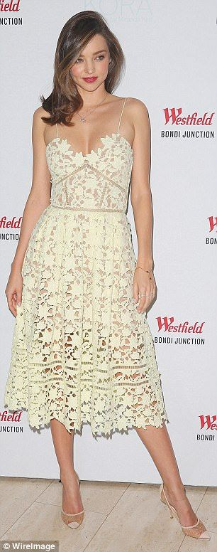 Miranda Kerr in Sydney wearing the Azalea Lace Dress, which sold out in just over 24 hours...