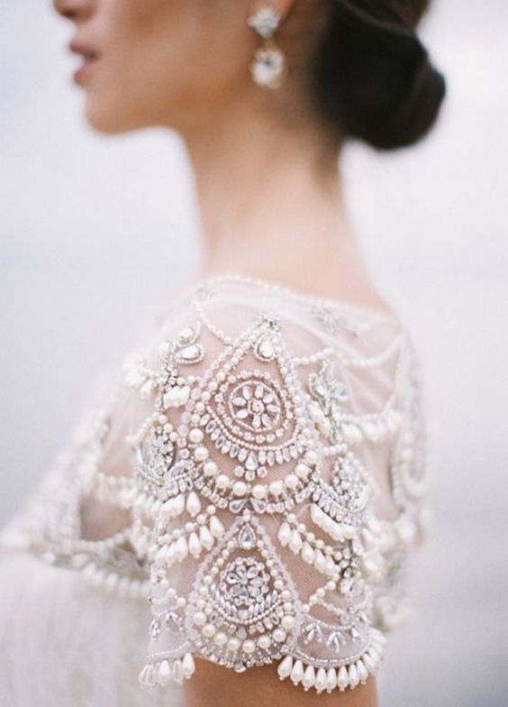 Intricate jewel embellished short sleeve white wedding dress; Featured Photographer: Feather And Stone Photography