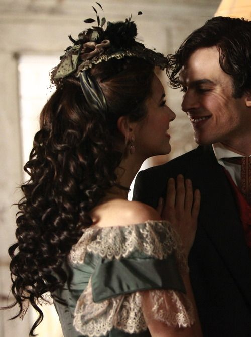 Nina Dobrev as Katherine Pierce and Ian Somerhalder as Damon Salvatore inThe Vampire Diaries (TV Series, 2010).