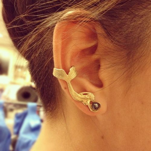 Any pretty, dainty mermaid cuff/earrings  I like this on cause shes reaching for a pearl! Any help is appreciated thank you