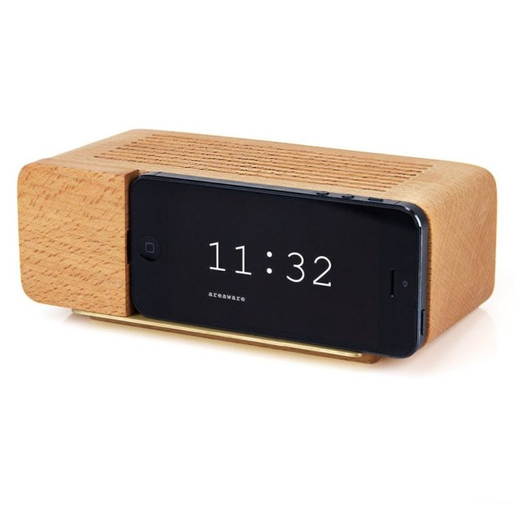 Areaware Decorative Alarm Dock for iPhone 5, Natural Beechwood / Remember those faux wood grain GE flip clocks that sat on every bedside table just a couple of decades ago? The Alarm Dock uses a nostalgic product language to meet the progressively thin and disappearing profiles of consumer electronics. | Buy on Amazon.com
