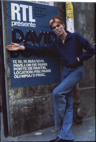 "Paris in May 1976, in front of the concert poster for the last leg of the European ""Station to Station"" tour."