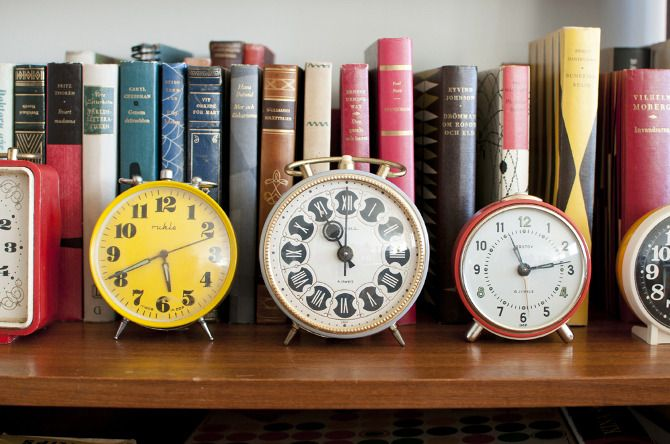 I have our small clock collection on one of our bookshelves in front of books. It looks great, a great idea!