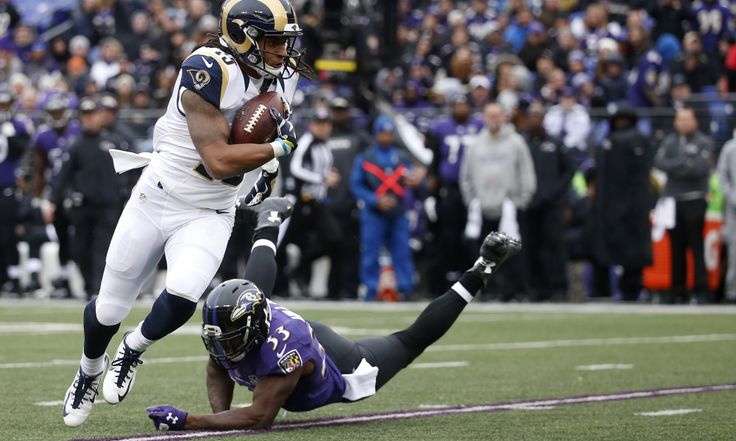 BALTIMORE, MD - NOVEMBER 22: Wide receiver Bradley Marquez #15 of the St. Louis Rams carries the ball past strong safety Will Hill #33 of the Baltimore Ravens in the second quarter at M&T Bank Stadium on November 22, 2015 in Baltimore, Maryland. (Photo by Rob Carr/Getty Images)