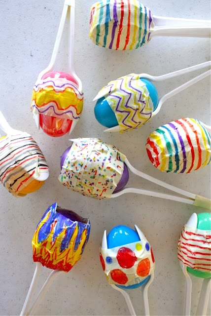 Maracas made from plastic spoons, plastic easter eggs and tape