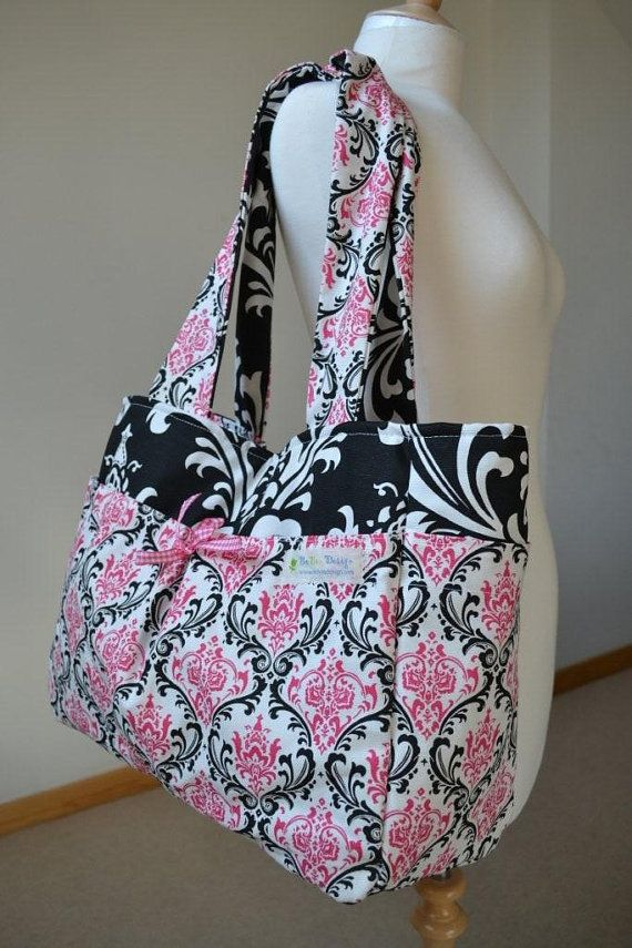 Love this pink and black fabric for a girl diaper bag!