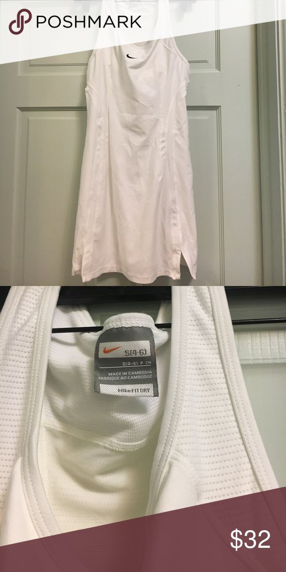 Barely worn Nike tennis dress, white, S (4-6) Nike tennis dress, size Small (4-6), maybe worn once or twice Nike Dresses