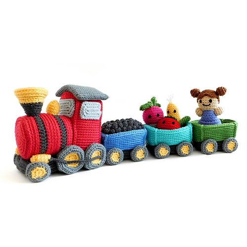 All aboard the Toy Box Express! This little locomotive, with its car ready to be filled with cargo and passengers, is waiting to leave the station and set off on all sorts of adventures!