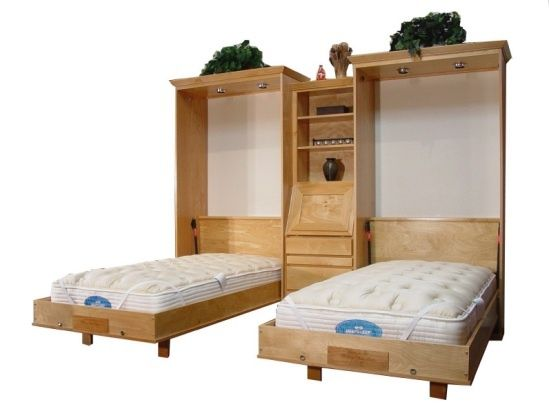 Murphy Beds for a kids bedroom. Bed doesn't take up all the play space when stored up. Great Idea.