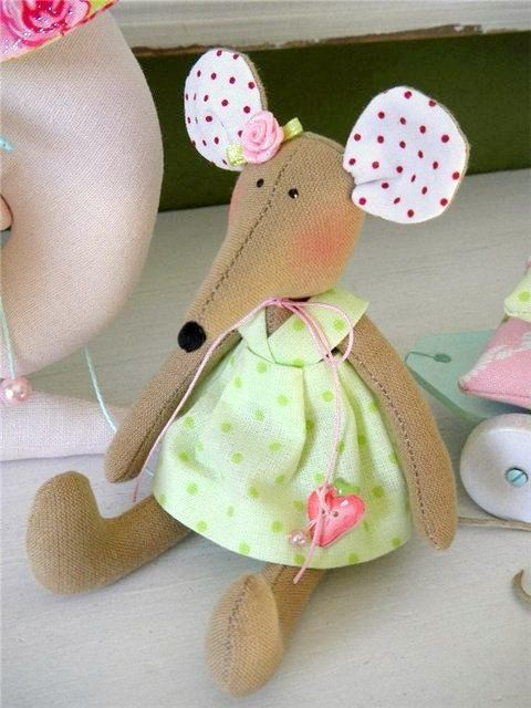 Cute little mouse.  Her dress is darling.