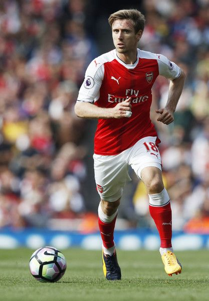 Arsenal's Spanish defender Nacho Monreal runs with the ball during the English Premier League football match between Arsenal and Manchester United at the Emirates Stadium in London on May 7, 2017.  / AFP PHOTO / Adrian DENNIS / RESTRICTED TO EDITORIAL USE. No use with unauthorized audio, video, data, fixture lists, club/league logos or 'live' services. Online in-match use limited to 75 images, no video emulation. No use in betting, games or single club/league/player publications.  /
