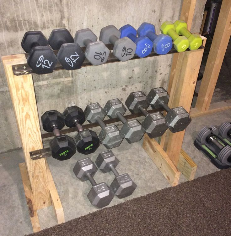 DIY Dumbbell Rack. I made this from scrap lumber and the iron rails are from an old bed frame. My total cost = $0.00!