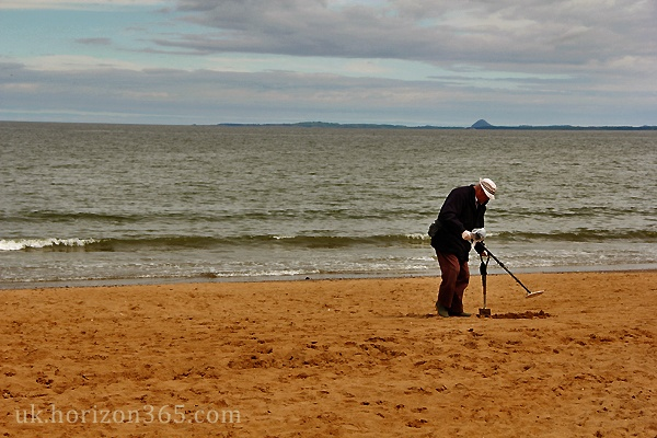 Old man searching for treasure on Portobello Beach, Edinburgh. Everyone is searching for something..