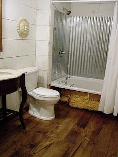 Cottage Dreamers: Pine wood floors in the bathroom;like the corrugated tin in tub shower; rust???