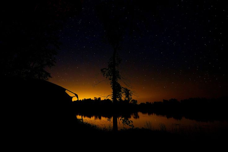 https://flic.kr/p/KVWrns | Sleeping under the stars | The sun is down, the water is calm and the camp fire is out.  Time to hit the tent - sunrise comes early.    The Milky Way was in our piece of the sky, but was too far to the west when I took this picture - and lost in the light pollution from Ottawa. Although, hours later we'd awaken to see it directly over the tent. Breathtaking.