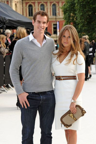 Kim Sears Photos Photos - Andy Murray and Kim Sears attend the Burberry London Fashion Week catwalk show. Murray, ranked third in the world in tennis, recently won the 2012 US Open, making him the first British man to win a Grand Slam singles tournament since 1936. - Andy Murray and Kim Sears at the Burberry Show