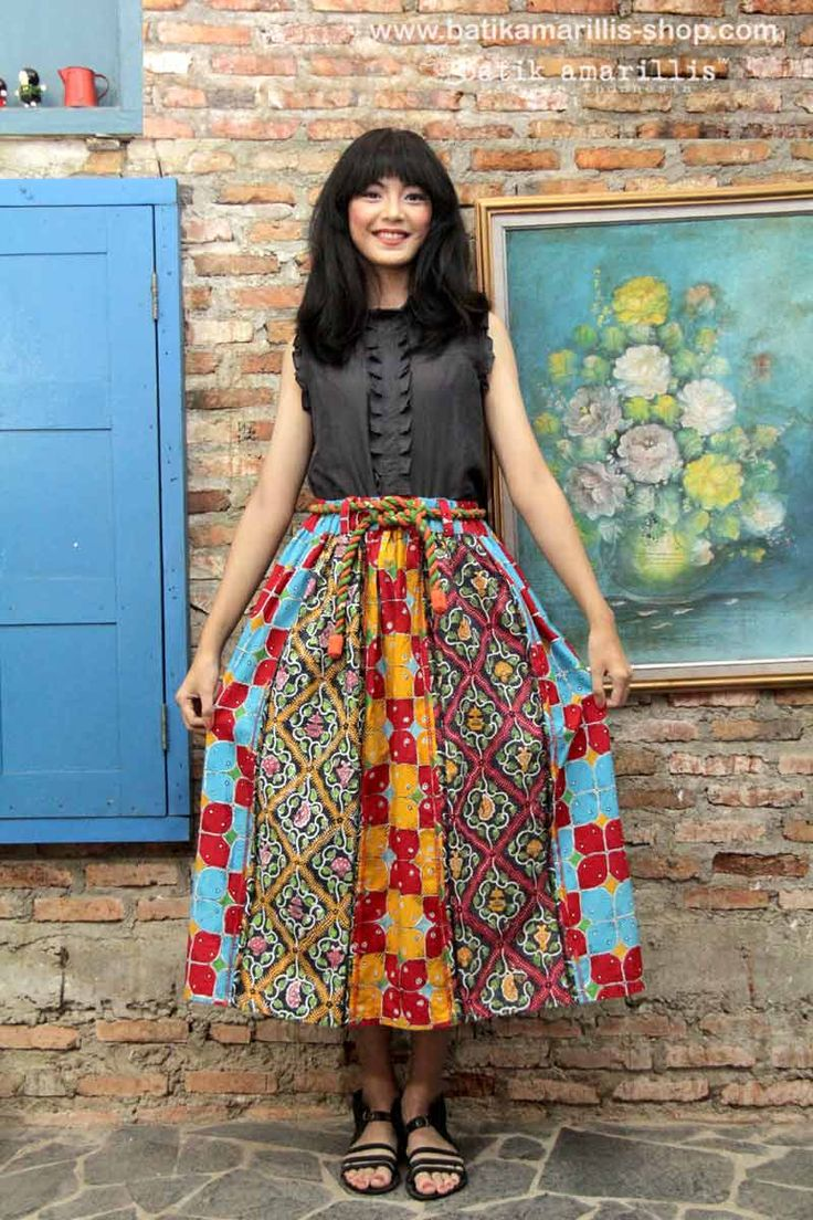 Batik Amarillis's Rainbow Crackers skirt  it's stunning patchworking batik skirt with raw and rustic details such as back stiches stand out as edgy decorative style ,it's 90ies inspired where the neo Bohemian, grunge music,dark lipstick, original super models were at their glory .