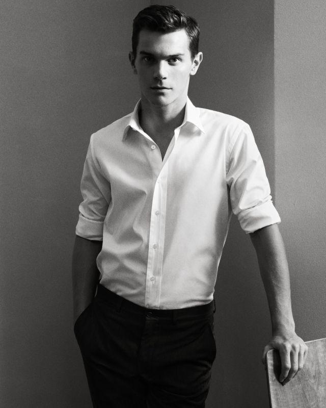 Ju's style. plain simple. white shirt. black pants.
