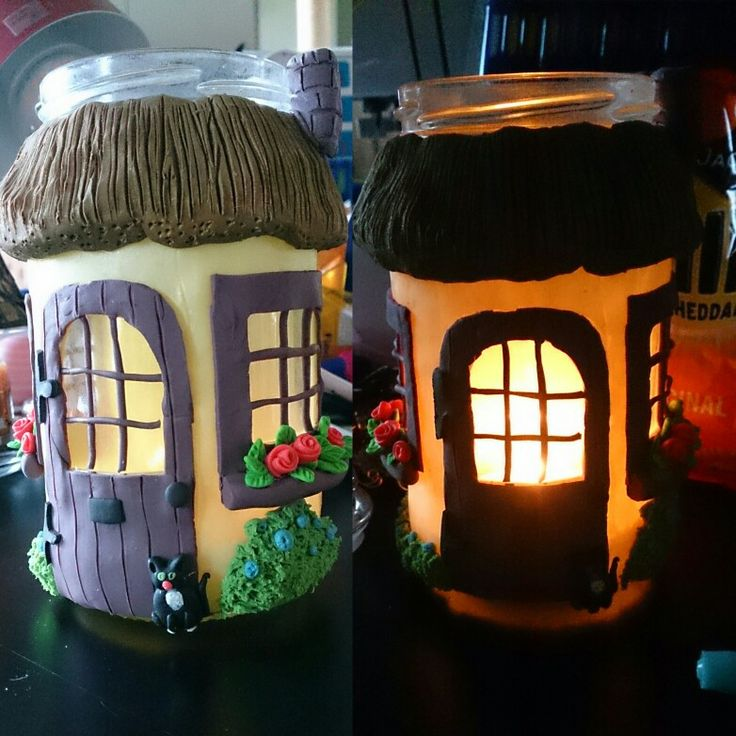Upcycled jar turned into a thatched cottage tea light holder.