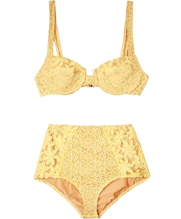 Lemon Bustier Bikini  Straight out of the 60s. In a pale lemon yellow crochet of daisies, the top has under-wire and a light padding in the paneled bustier cups, with adjustable wider shoulder straps and silver hardware closure in the back. Bottoms are hi waisted and low-cut on the leg openings. Very true to style.