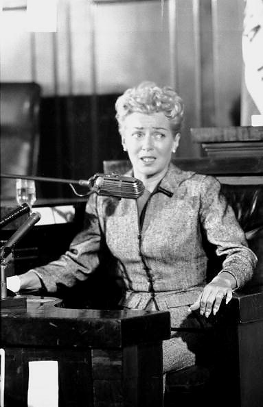 Los Angeles, California, April 1958: Lana Turner testifies at a coroner's inquest over the death by stabbing of her then-boyfriend, Johnny Stompanato, by Lana's teenage daughter, Cheryl Crane. The case was eventually ruled a justified homicide.    Some say Lana's testimony that day was the acting performance of her life.